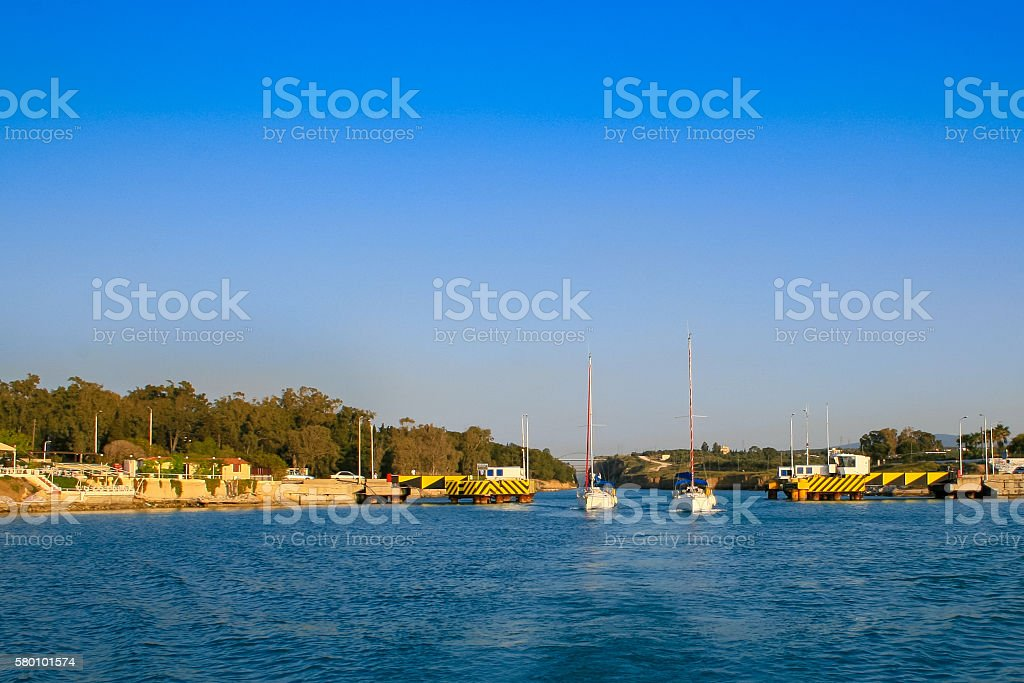 Two sailing yachts at the entrance to the Corinthian Canal. stock photo