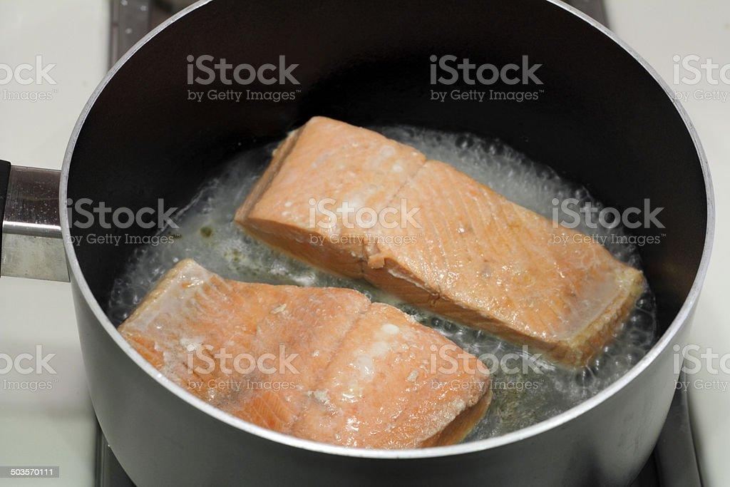 Two Salmon Fillets Poaching stock photo
