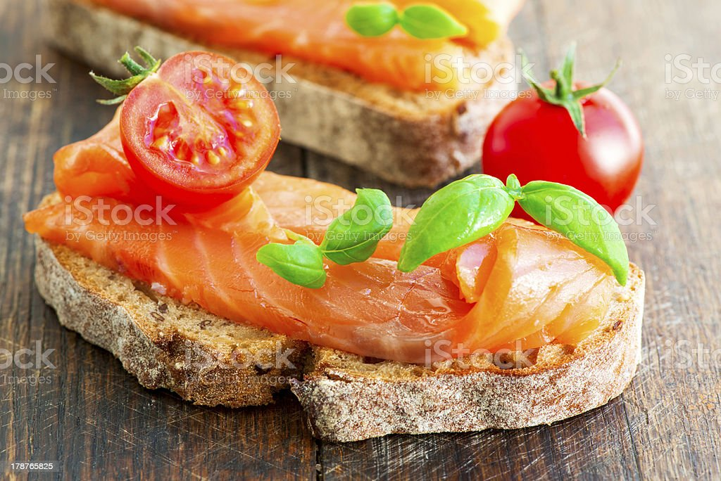 Two salmon sandwiches on wooden table royalty-free stock photo