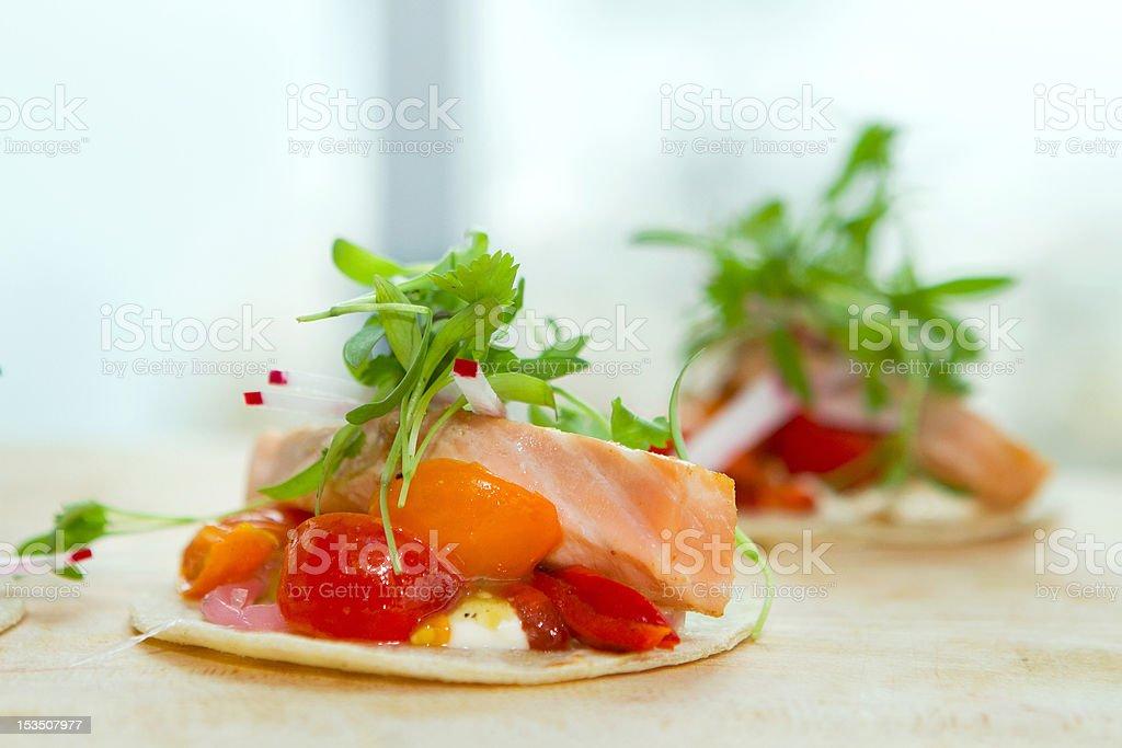 Two salmon taquitos royalty-free stock photo