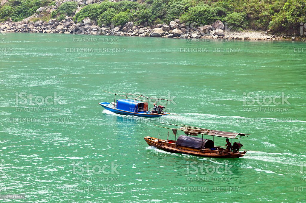 Two Sampans Flowing Along Yangtze River in China stock photo