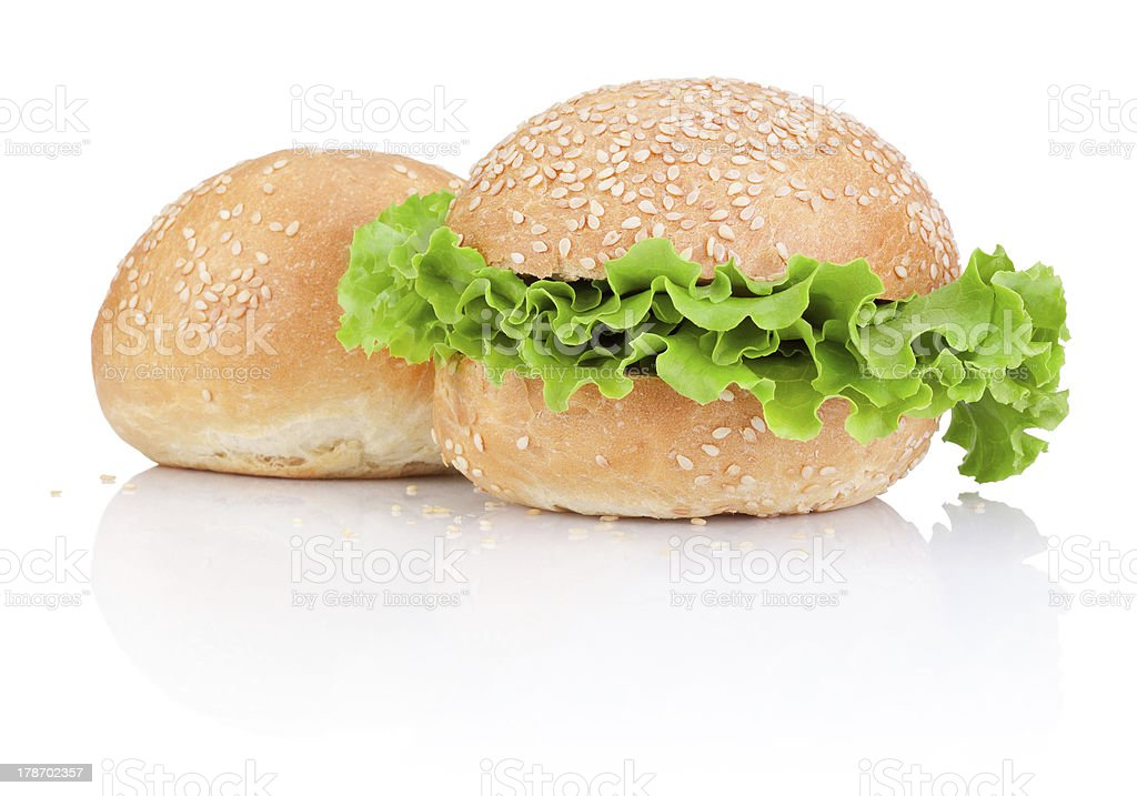 Two Sandwich bun with green salad leaf isolated on white royalty-free stock photo