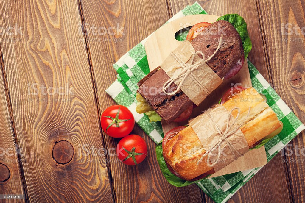 Two sandwiches with salad, ham, cheese stock photo