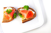 Two sandwiches with smoked salmon