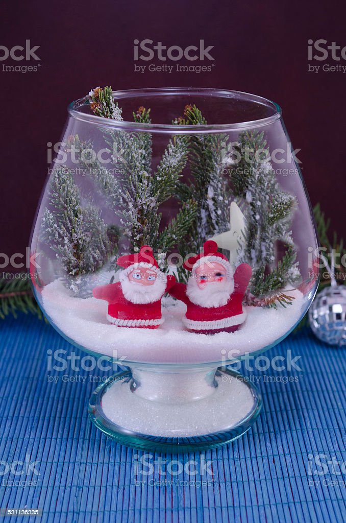 Two Santas in a glass bowl covered with snow royalty-free stock photo