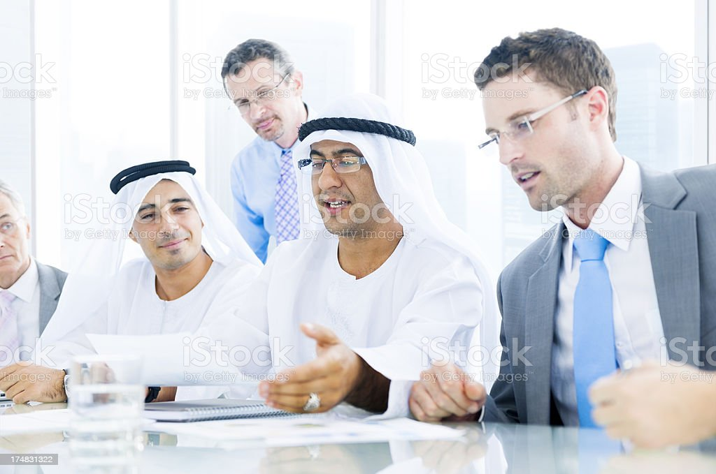 Two Saudi and two Caucasian businessmen discussing matters royalty-free stock photo