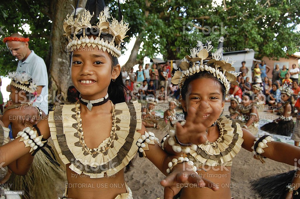 Two school children performing traditional dance stock photo