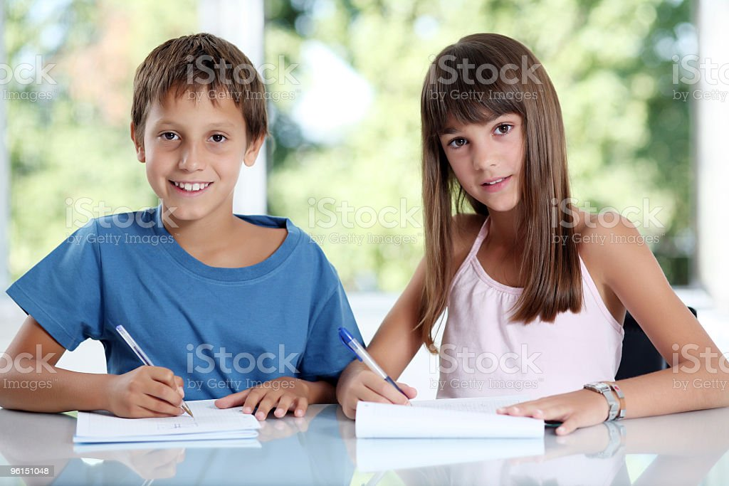 Two schoolchildren learning in classroom. royalty-free stock photo