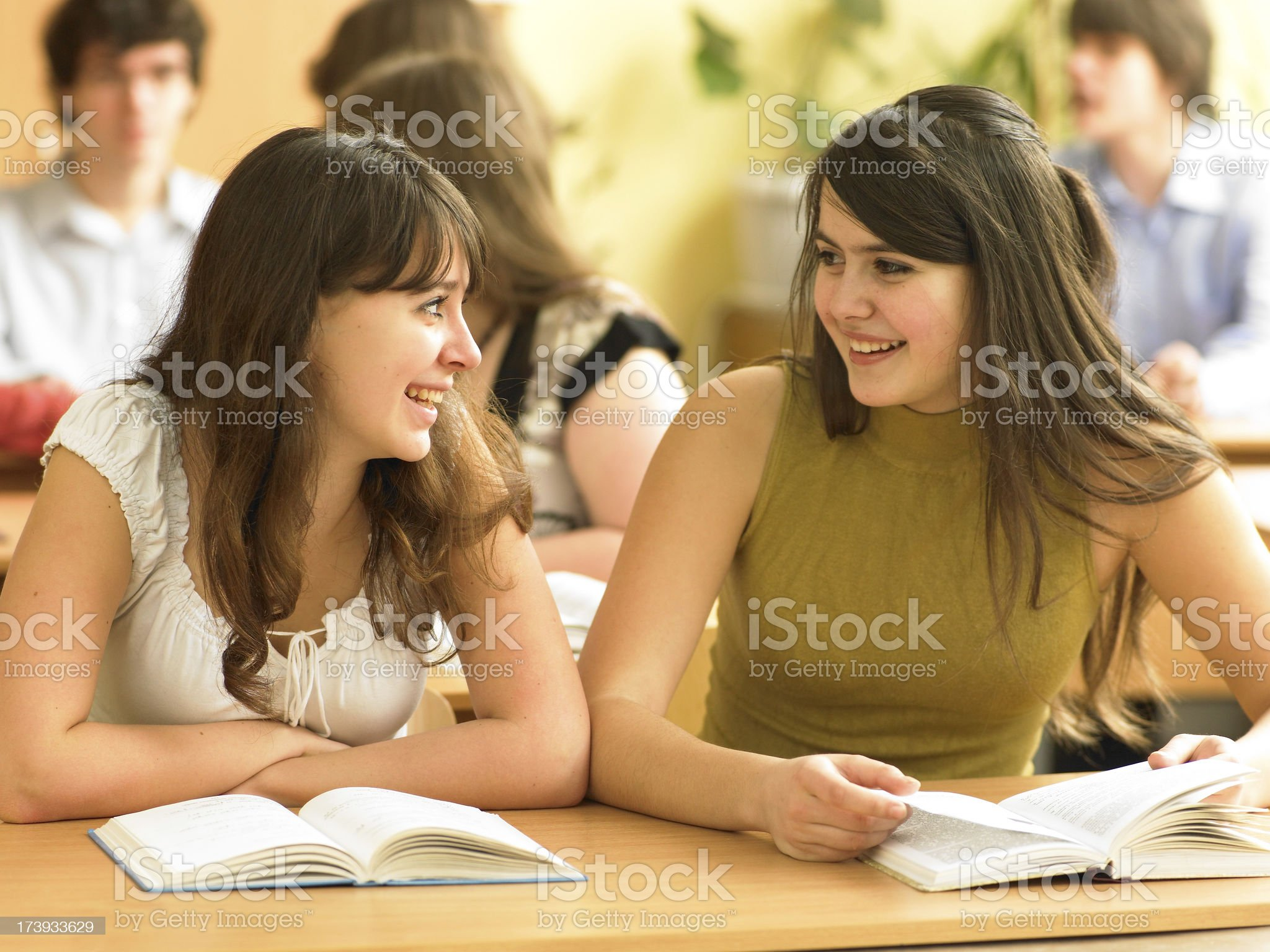 Two schoolgirls are chatting royalty-free stock photo