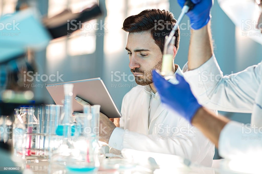 two scientist using digital tablet in laboratory stock photo