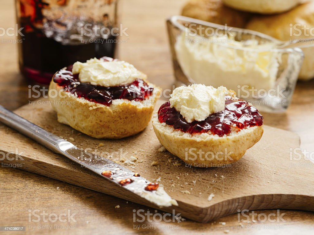Two scones with clotted cream and jam stock photo