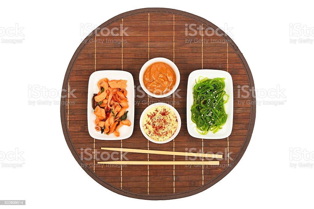 Two seafood salads on bamboo mat royalty-free stock photo