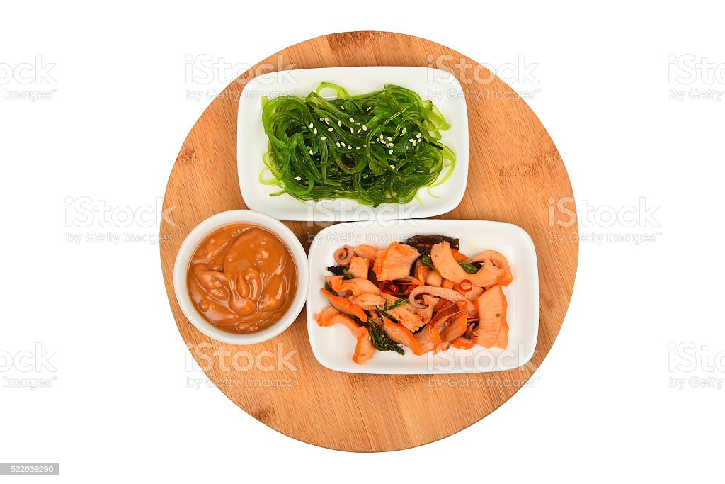 Two seafood salads on wooden plate royalty-free stock photo