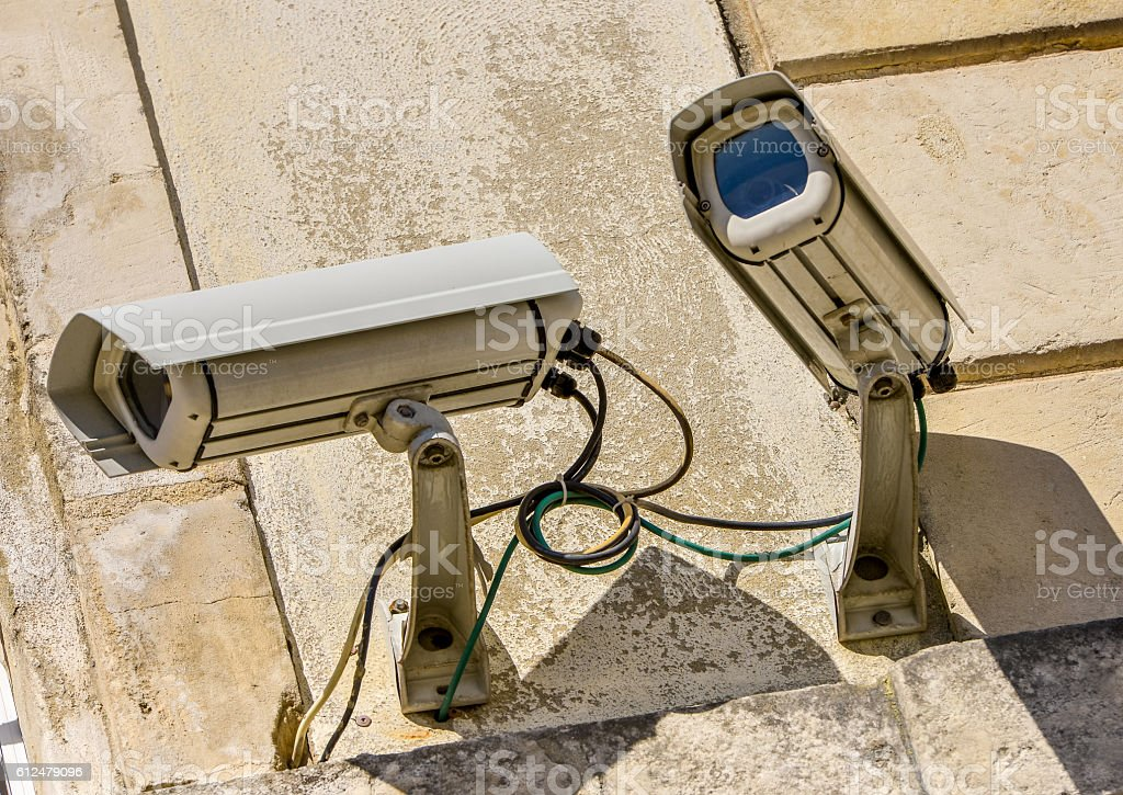 two security CCTV cameras or surveillance system in office building stock photo
