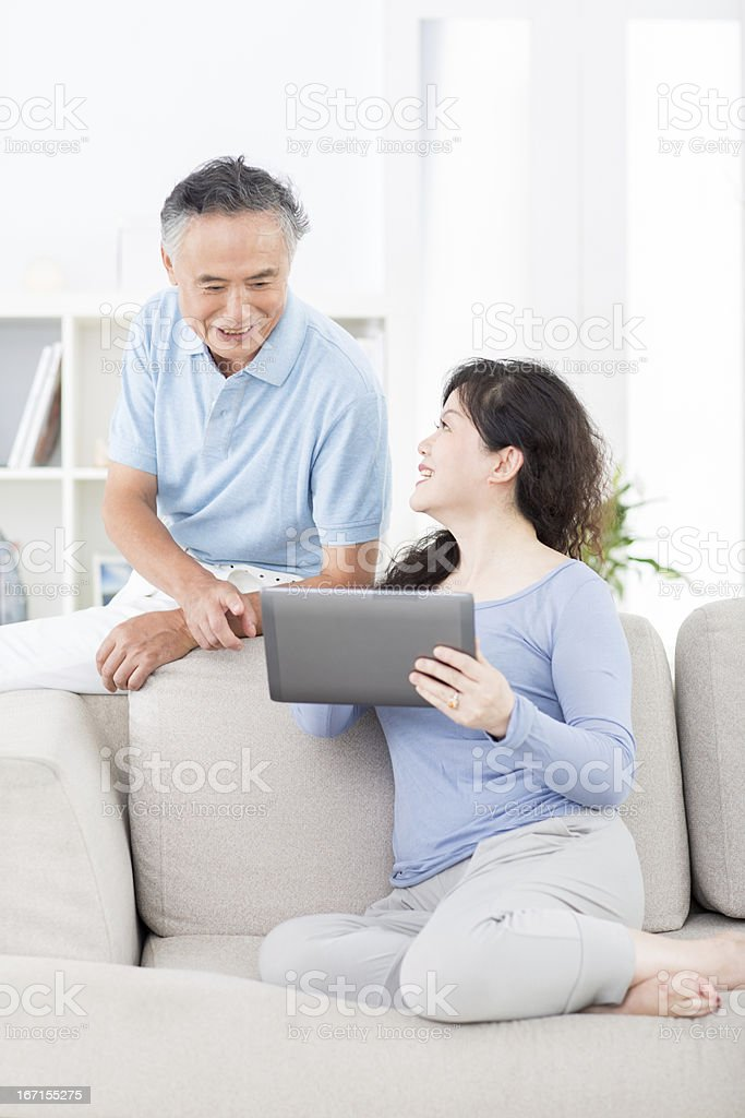Two senior asian people with digital tablet royalty-free stock photo