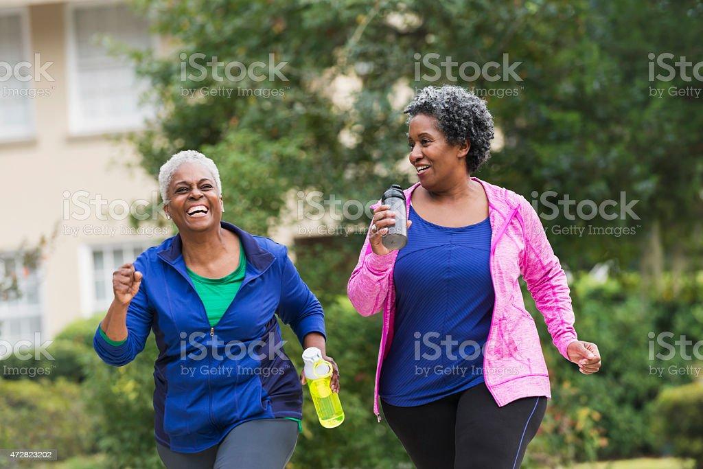 Two senior black women exercising together stock photo