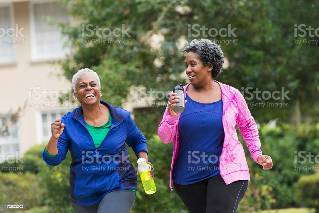 Two senior black women exercising together stock photo