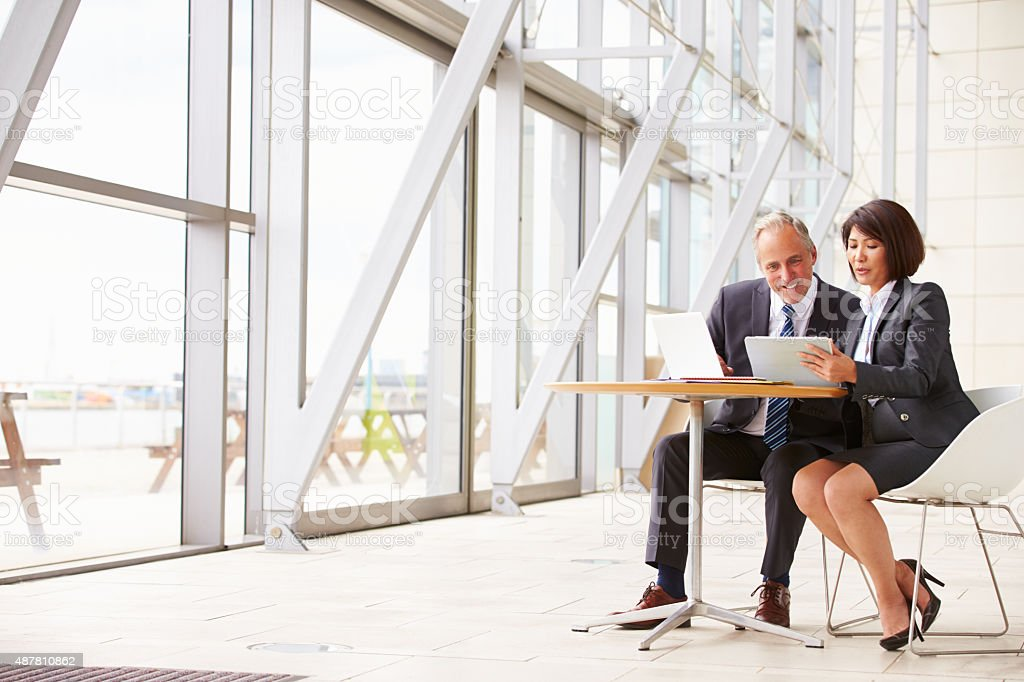 Two senior business colleagues at meeting in modern interior stock photo