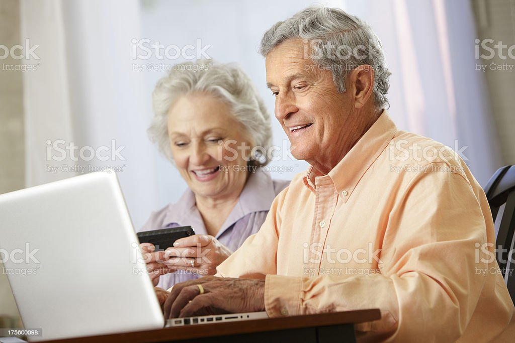 Two senior citizens using technology royalty-free stock photo