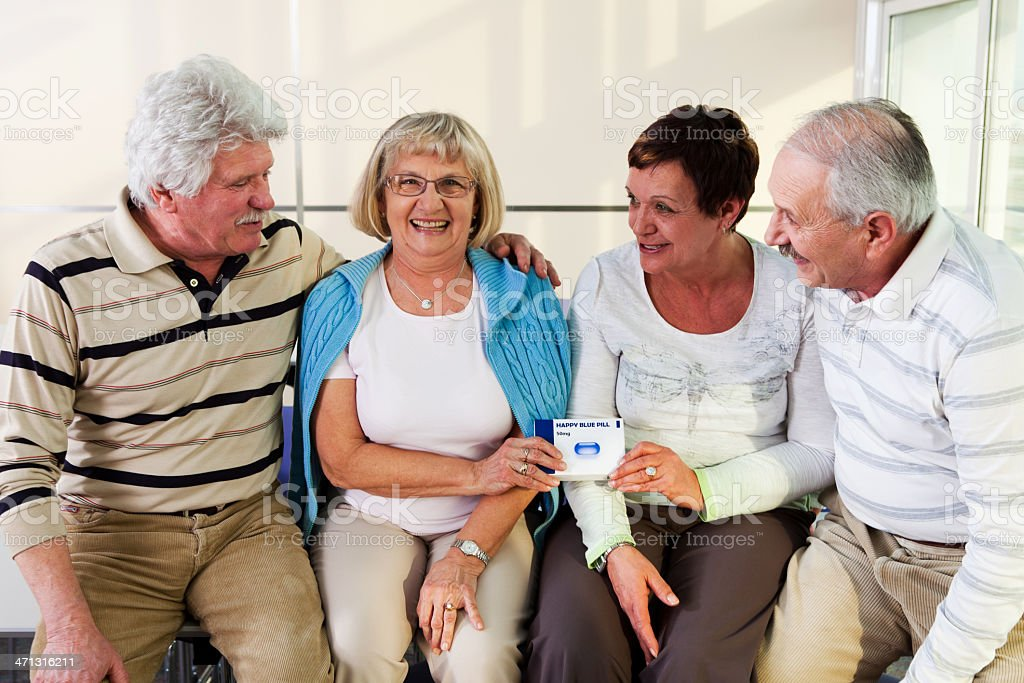 Two senior couple holding pack of  pills in their hands royalty-free stock photo