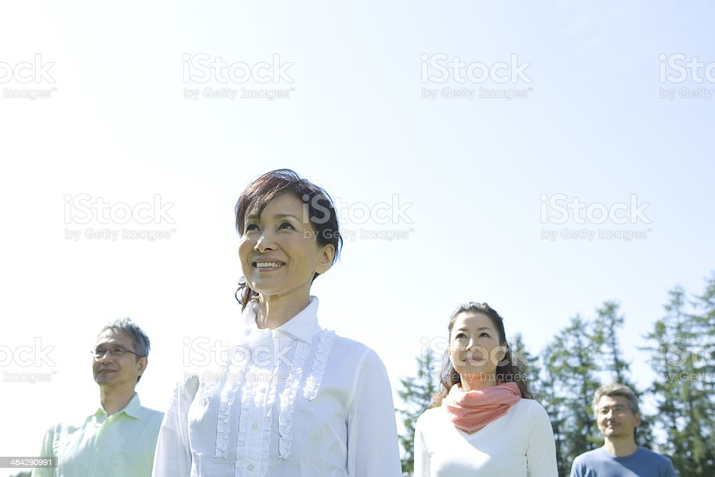 Two senior couples standing still under blue sky royalty-free stock photo