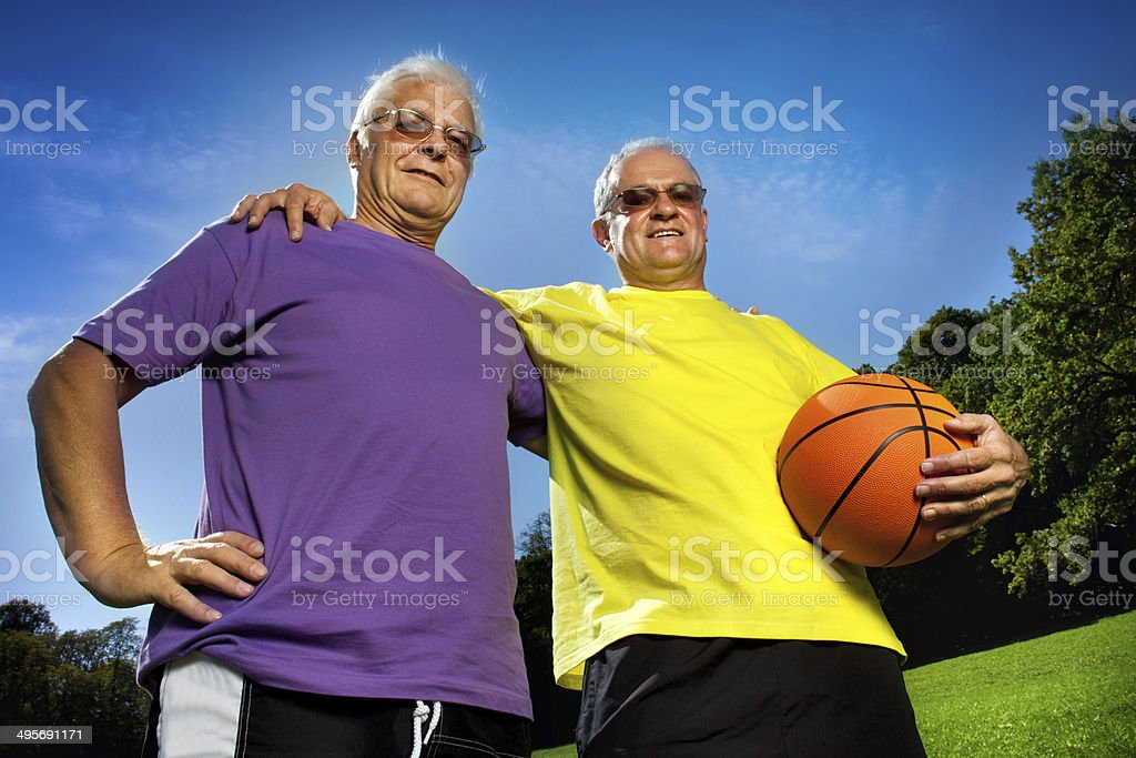 two senior friends after basketball match stock photo