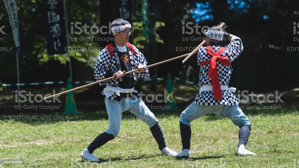 Two senior men fighting a kendo in Japan stock photo