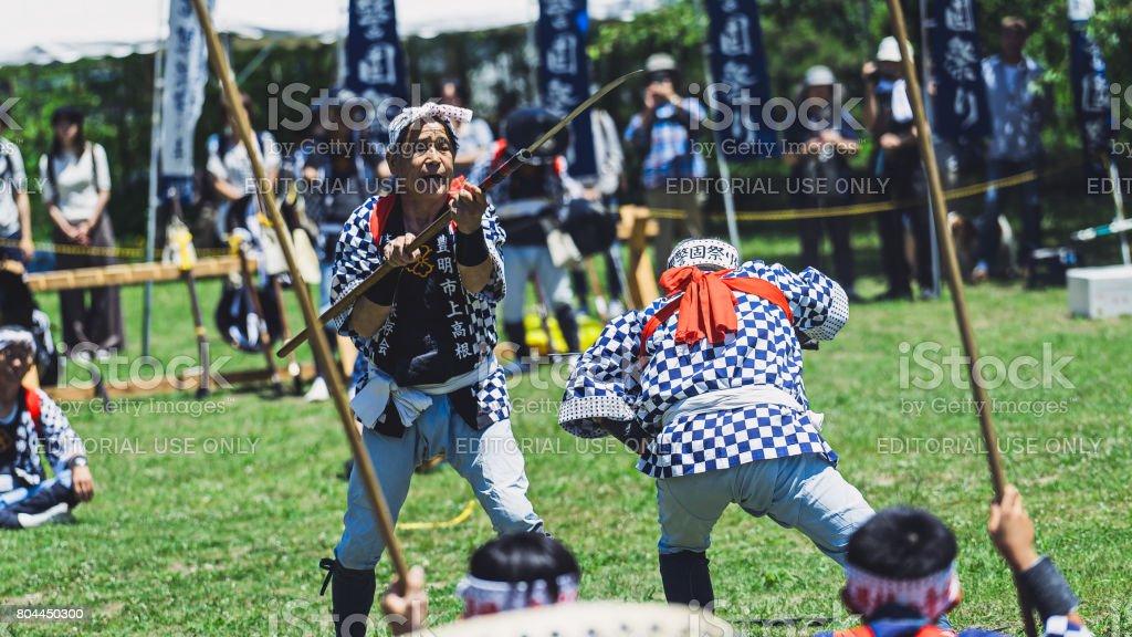 Two senior men fighting by katana sword in Japan stock photo