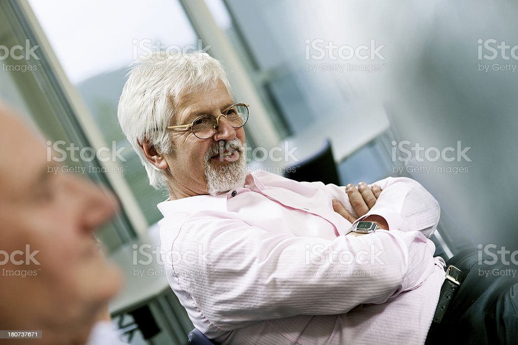 Two senior men on group therapy royalty-free stock photo