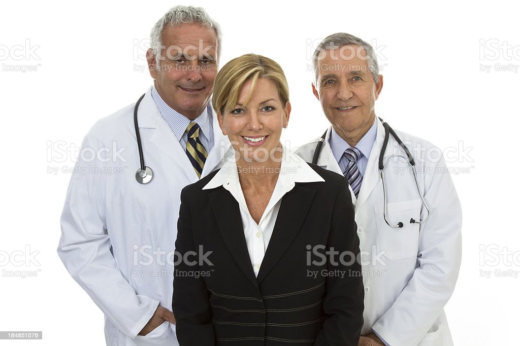 Two senior smiling doctors and businesswoman white background stock photo