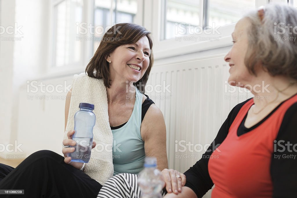 Two senior women relaxing after yoga class royalty-free stock photo