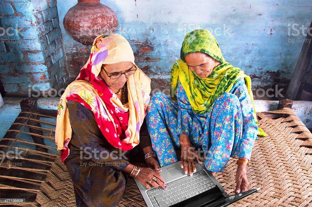 Two Senior Women Using Laptop stock photo