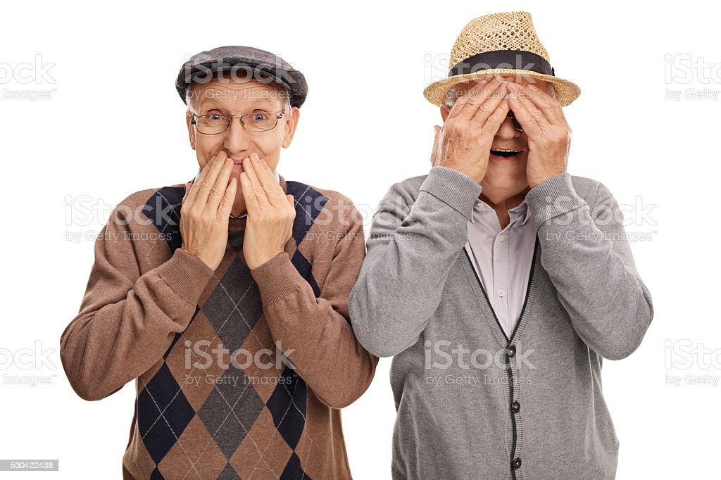 Two seniors covering their eyes and mouth stock photo
