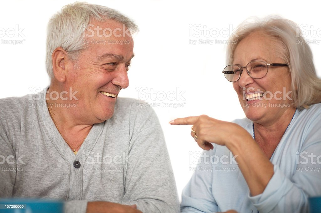 Two seniors having fun at breakfast royalty-free stock photo