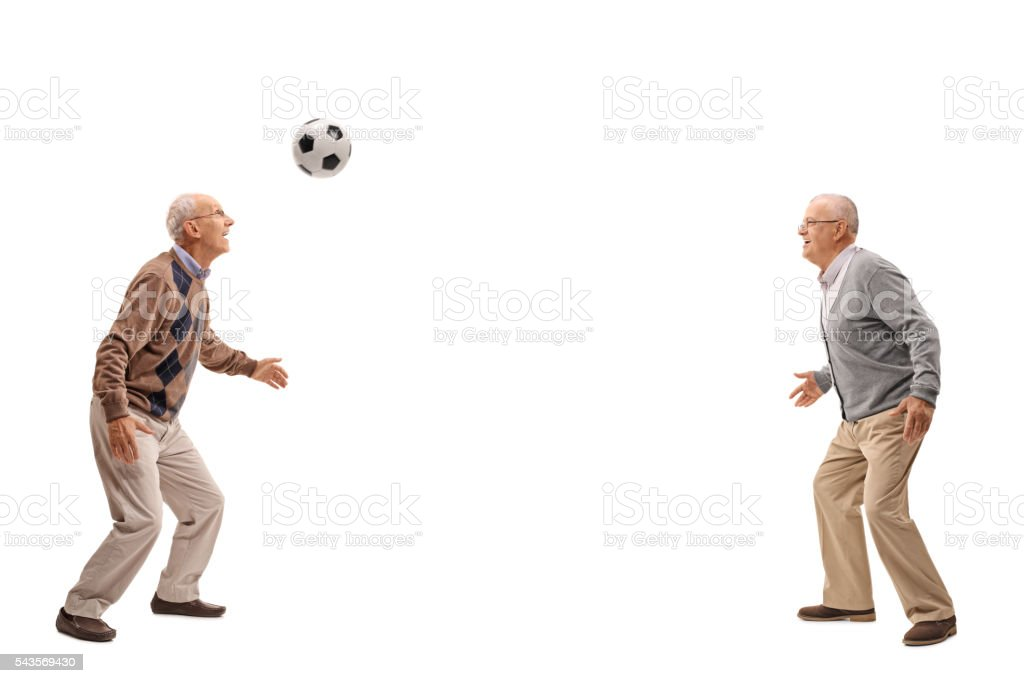 Two seniors passing a football stock photo