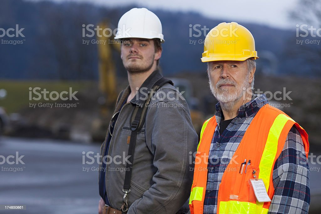 Two serious faced male construction workers. royalty-free stock photo