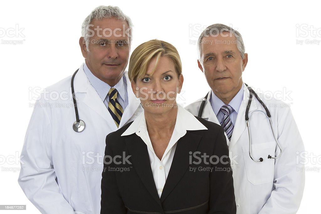 Two serious senior doctors and one businesswoman stock photo