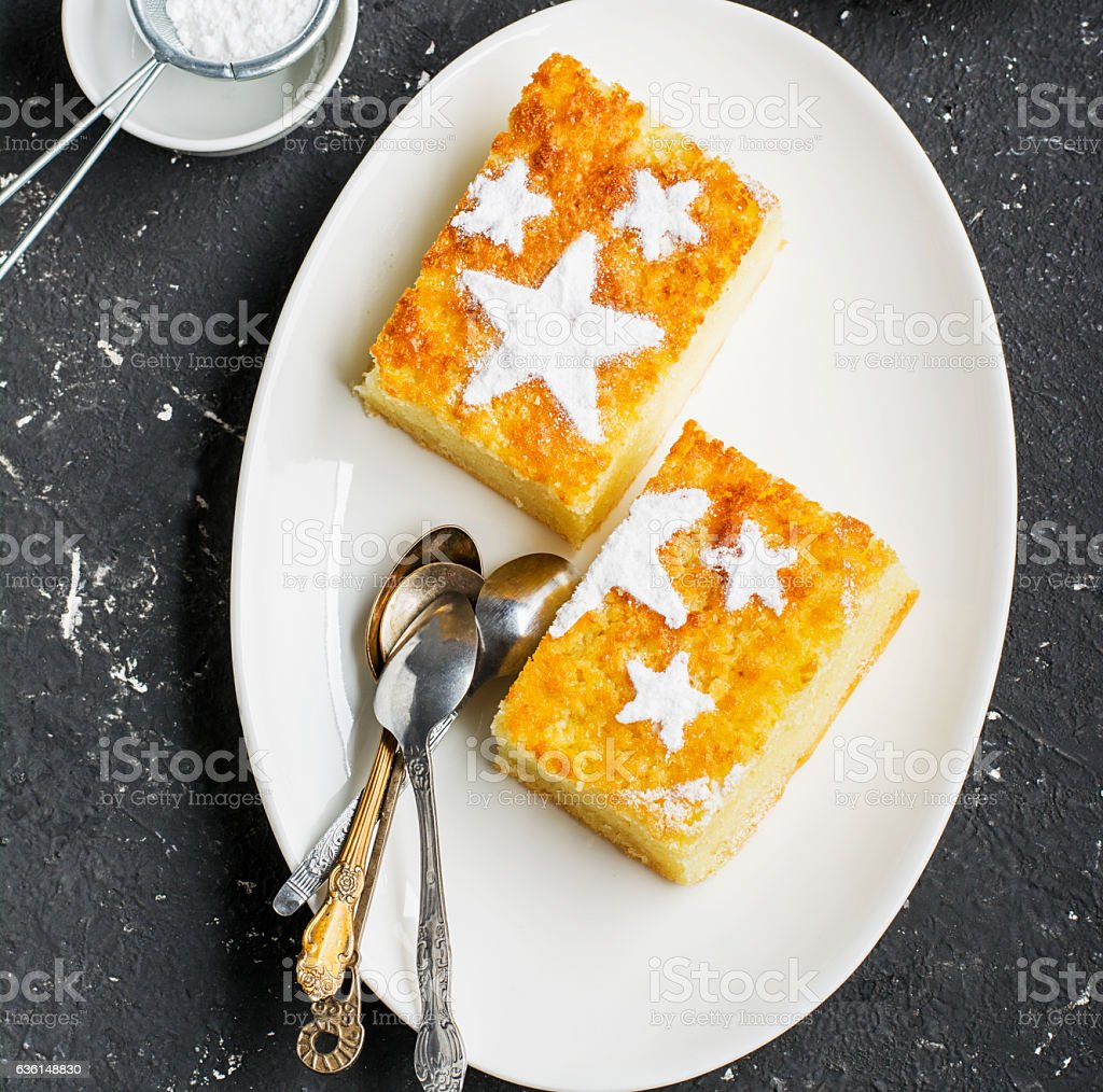 Two servings of homemade juicy mandarin biscuit with asterisks from stock photo