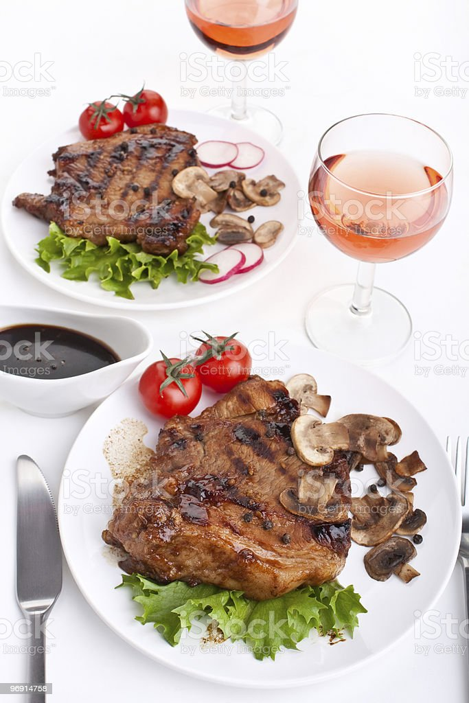 two servings of pork chops royalty-free stock photo