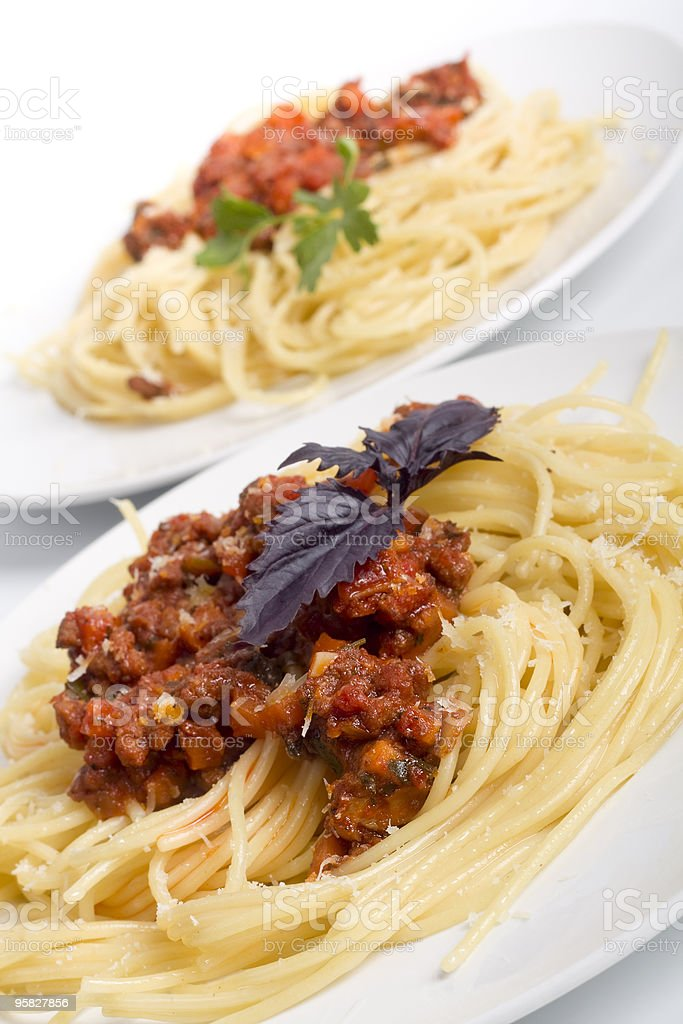 two servings of spaghetti bolognese royalty-free stock photo