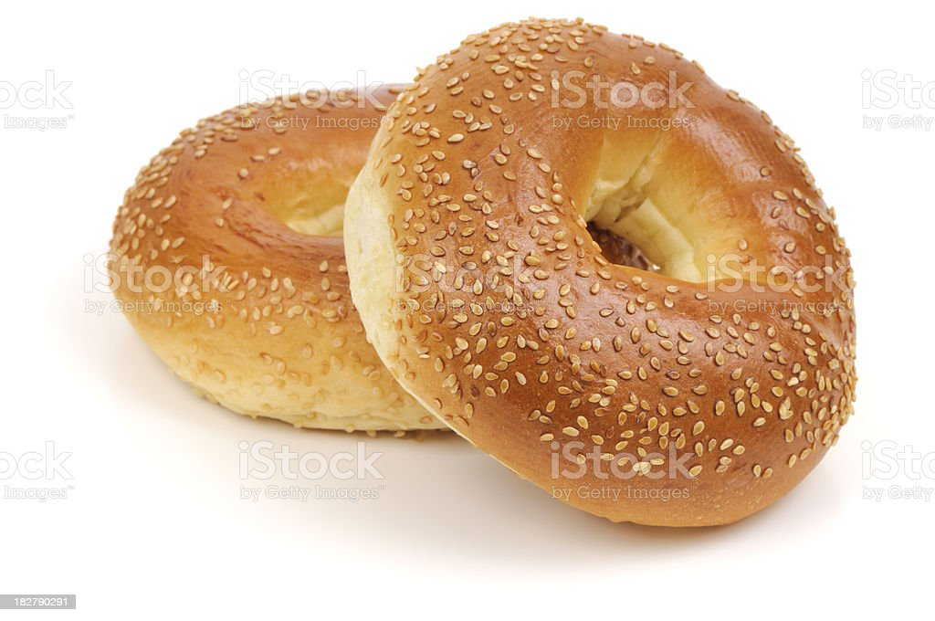 Two Sesame Seed bagels isolated on white background stock photo