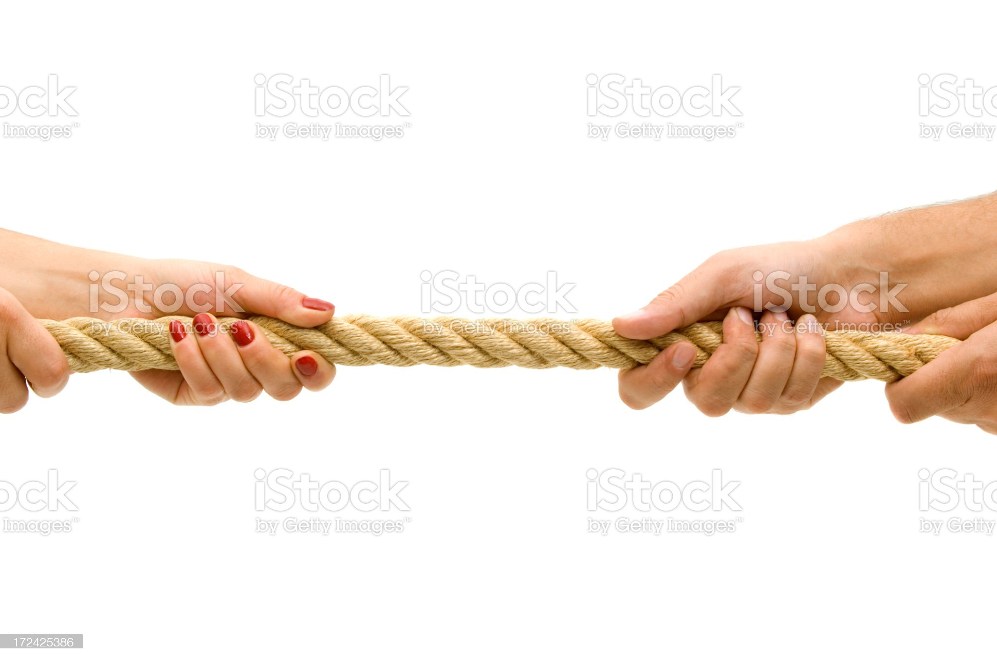 Two sets of hands pulling a rope from opposite sides royalty-free stock photo