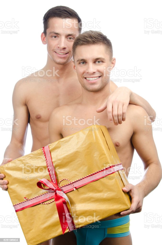 Two sexy guy and gift. stock photo