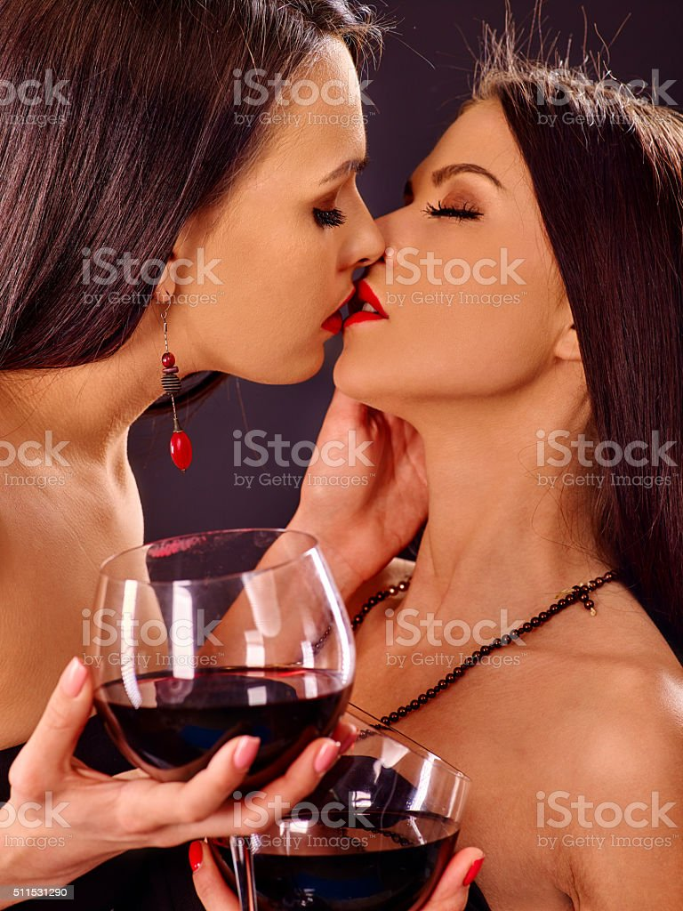 Two sexy lesbian women with red wine stock photo