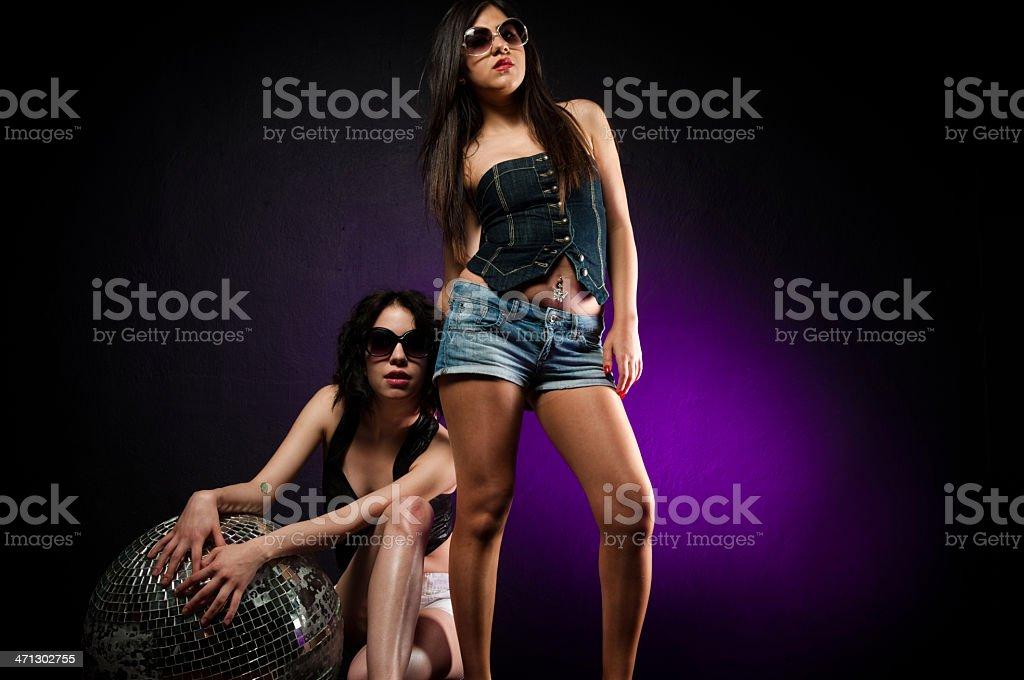 Two sexy women at disco stock photo
