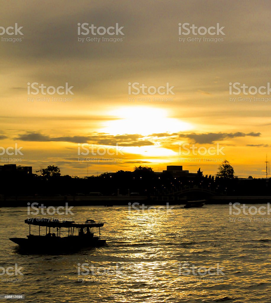 two shadow boat in river and sunset yellow light stock photo