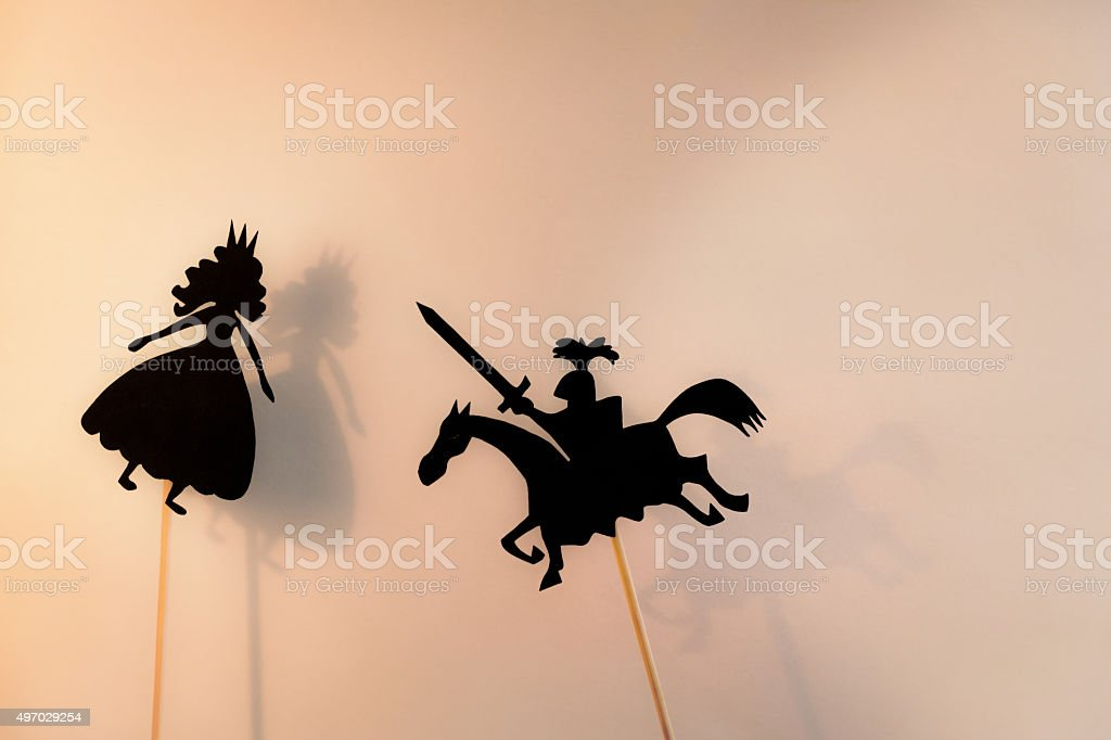 Two shadow puppets, copy space background. stock photo