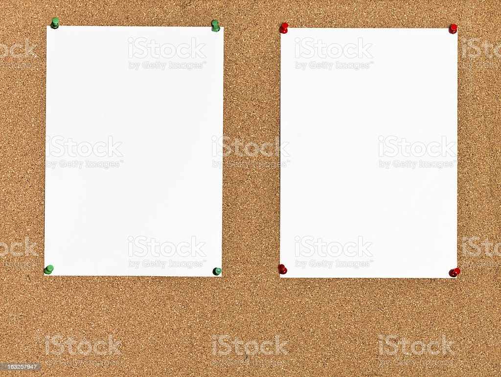 two sheets of paper on cork board royalty-free stock photo