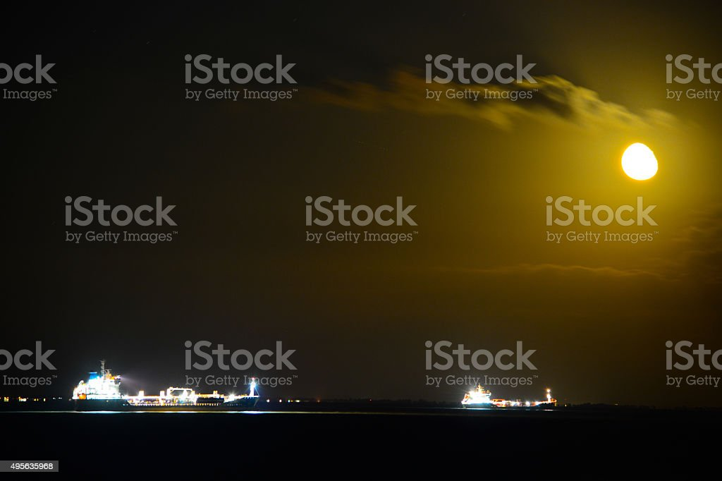 Two Ships and the Moon stock photo