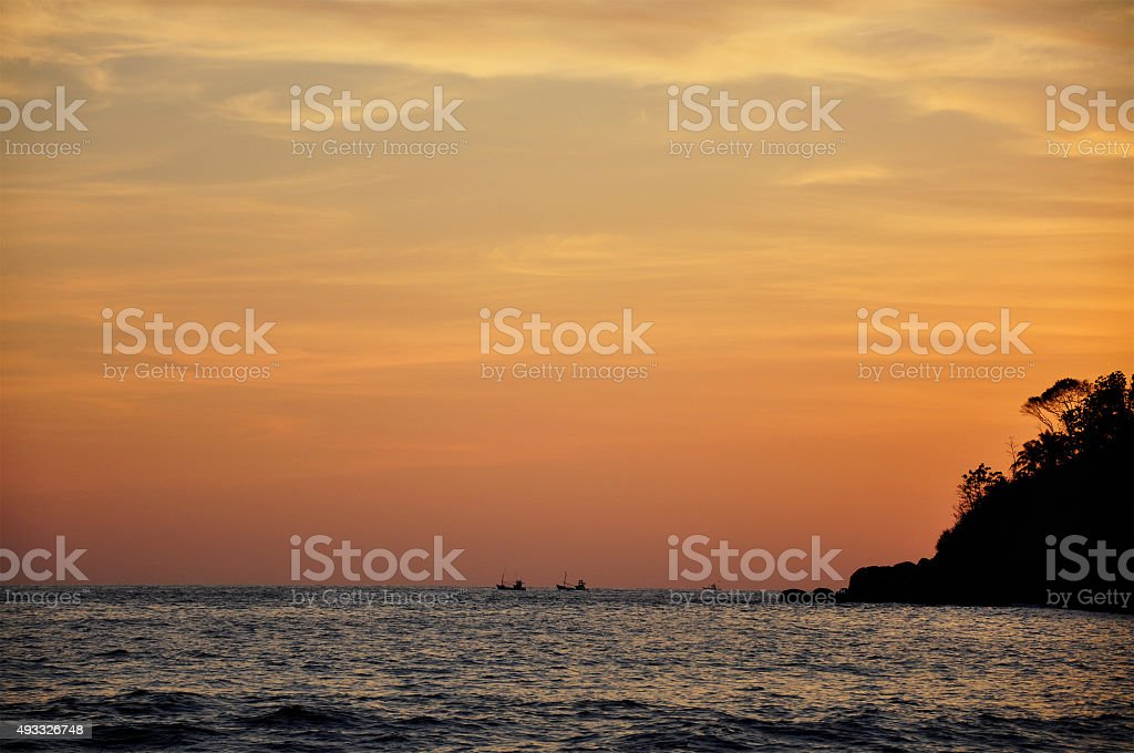 Two ships sailing in the ocean at sunset stock photo